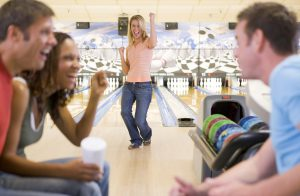 group of young adults bowling