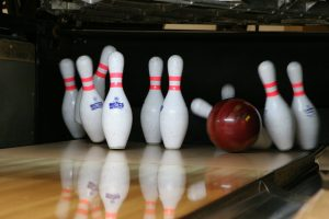 Bowling ball striking bowling pins